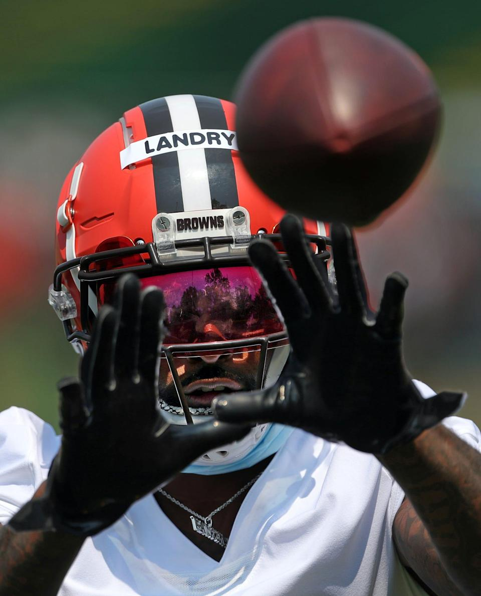 Cleveland Browns wide receiver Jarvis Landry eyes down a pass during NFL football training camp, Wednesday, July 28, 2021, in Berea, Ohio.