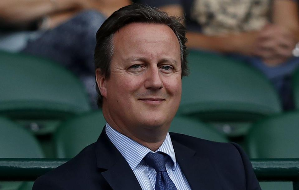 Britain's former Prime Minister David Cameron sits in the Royal Box on Centre Court following the women's singles semi-finals on the tenth day of the 2017 Wimbledon Championships at The All England Lawn Tennis Club in Wimbledon, southwest London, on July 13, 2017. / AFP PHOTO / Adrian DENNIS / RESTRICTED TO EDITORIAL USE        (Photo credit should read ADRIAN DENNIS/AFP/Getty Images)