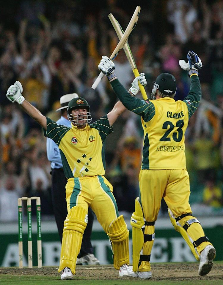 SYDNEY, AUSTRALIA - JANUARY 23: Ricky Ponting and Michael Clarke of Australia celebrate Clarke's century off the last run of the match during game five of the VB Series One Day International Tournament between Australia and the Pakistan played at the SCG on January 23, 2005 in Sydney, Australia.  (Photo by Hamish Blair/Getty Images)