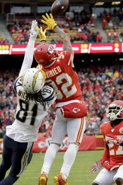 Kansas City Chiefs safety Tyrann Mathieu (32) intercepts a pass intended for Los Angeles Chargers wide receiver Mike Williams (81), as cornerback Rashad Fenton (27) watches, during the first half of an NFL football game in Kansas City, Mo., Sunday, Dec. 29, 2019. (AP Photo/Charlie Riedel)