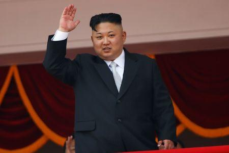 FILE PHOTO:North Korean leader Kim Jong Un waves to people attending a military parade marking the 105th birth anniversary of country's founding father, Kim Il Sung in Pyongyang