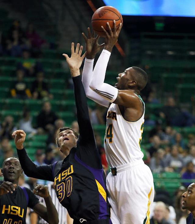 Baylor forward Cory Jefferson, right, shoots over Hardin-Simmons Jim Walker (30) in the second half of an NCAA college basketball game Sunday, Dec. 1, 2013, in Waco, Texas. (AP Photo/The Waco Tribune-Herald, Rod Aydelotte)