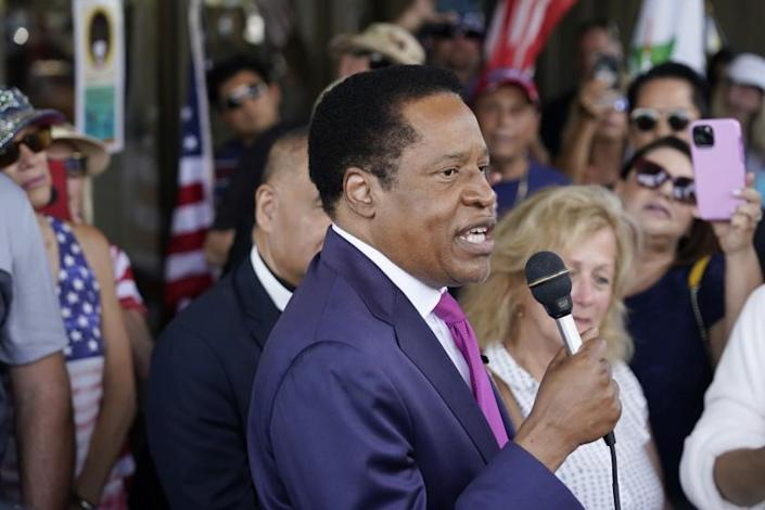 FILE - In this July 13, 2021, file photo, conservative radio talk show host Larry Elder speaks to supporters during a campaign stop in Norwalk, Calif. Elder was not on the list of candidates released Saturday in the recall election that could end the term of California Gov. Gavin Newsom. (AP Photo/Marcio Jose Sanchez, File)