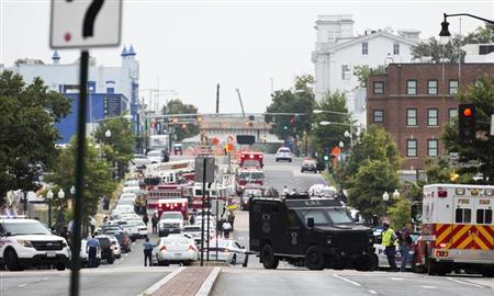 Police block off the M Street, SE, as they respond to a shooting at the Washington Navy Yard in Washington, September 16, 2013. The U.S. Navy said several people were injured and there were possible fatalities in the shooting at the Navy Yard in Washington D.C. on Monday. The Navy did not immediately provide additional details but a Washington police spokesman said earlier that five people had been shot, including a District of Columbia police officer and one other law enforcement officer. REUTERS/Joshua Roberts