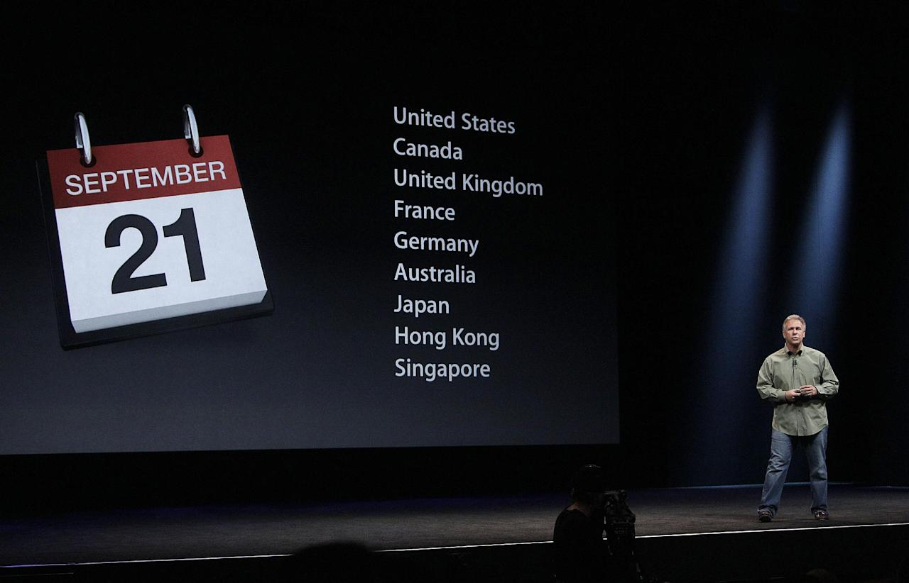 Phil Schiller, Apple's senior vice president of worldwide marketing, gives release dates of the iPhone 5 during an Apple event in San Francisco, Wednesday, Sept. 12, 2012. (AP Photo/Jeff Chiu)