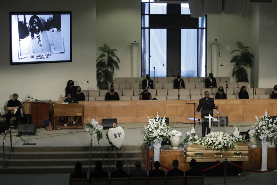 FILE - In this June 30, 2020, file photo, a pastor eulogizes Robert Fuller, pictured top left, during his funeral in his honor in Littlerock, Calif. A police investigation confirmed suicide was the cause of death of Fuller, a Black man found hanging from a tree in a Southern California city park last month, authorities said Thursday, July 9, 2020. (AP Photo/Marcio Jose Sanchez, File)