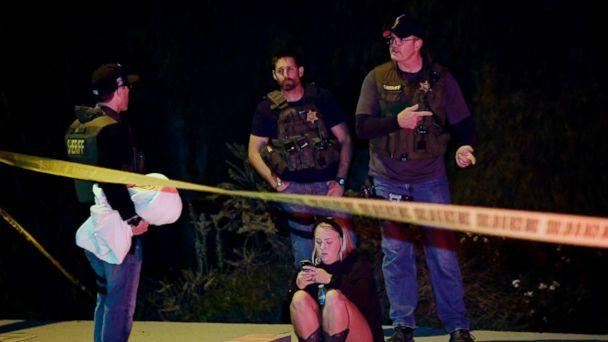 PHOTO: Sheriff's deputies speak to a potential witness as they stand near the scene where a gunman opened fire, Nov. 8, 2018, in Thousand Oaks, Calif. (Mark J. Terrill/AP)