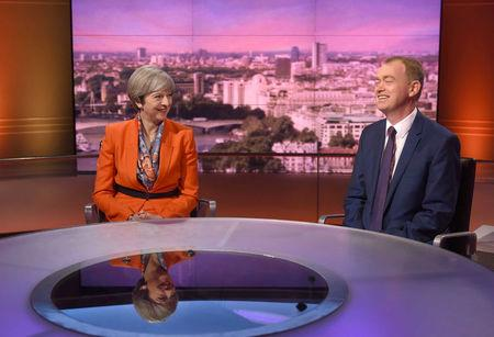 Britain's Prime Minister Theresa May and Tim Farron, the leader of the Liberal Democrats, attend the BBC's Marr Show in London, Britain April 30, 2017. Jeff Overs/BBC Handout via REUTERS