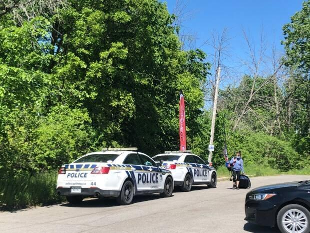Gatineau Police Service patrol cars are parked near the scene of a skydiving accident near the city's airport on May 29, 2021. Two men died in the accident, police told Radio-Canada. (Marielle Guimond/Radio-Canada - image credit)