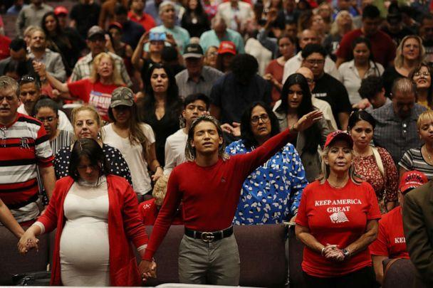 PHOTO: People pray together during the 'Evangelicals for Trump' campaign event held at the King Jesus International Ministry as they await the arrival of President Donald Trump on Jan, 3, 2020 in Miami. (Joe Raedle/Getty Images, FILE)