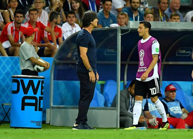 Soccer Football - World Cup - Group F - Germany vs Sweden - Fisht Stadium, Sochi, Russia - June 23, 2018 Germany's Mesut Ozil near coach Joachim Low REUTERS/Dylan Martinez TPX IMAGES OF THE DAY