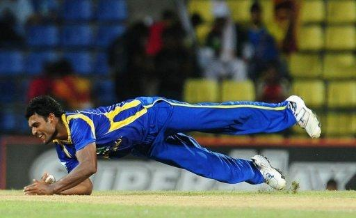 Sri Lankan cricketer Thisara Perera takes a catch to dismiss Pakistan cricketer Mohammad Hafeez