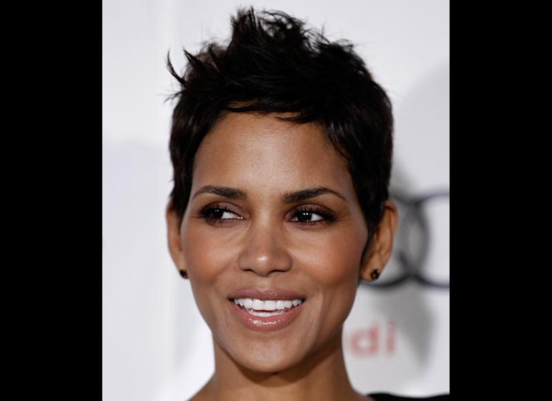 "FILE - In a Nov. 9, 2010 file photo, actress Halle Berry arrives at ""On Acting - A Conversation with Halle Berry"" during American Film Institute's AFI Fest 2010 in Los Angeles. Berry was taken to a hospital after falling and striking her head on concrete late Tuesday, July 17, 2012, but was later discharged. The 45-year-old Academy Award-winner fell around 10 p.m. Tuesday while shooting a movie and was rushed by ambulance to Cedars-Sinai Medical Center. (AP Photo/Matt Sayles, File)"