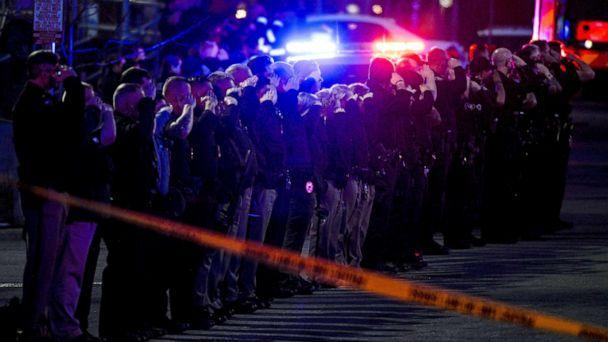 PHOTO: Law enforcement officers salute as emergency vehicles escort the body of slain police officer Eric Talley from the scene of a shooting at a King Soopers grocery store in Boulder, Colo., March 22. 2021. (Michael Ciaglo/USA Today via Reuters)