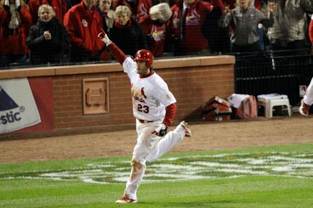 David Freese of the St. Louis Cardinals celebrates after hitting a walk off solo home run in the 11th inning to win Game Six of Major League Baseball's 2011 World Series against the Texas Rangers -- forcing a Game Seven that the Cards would go on to win (AFP Photo/Rob Carr)