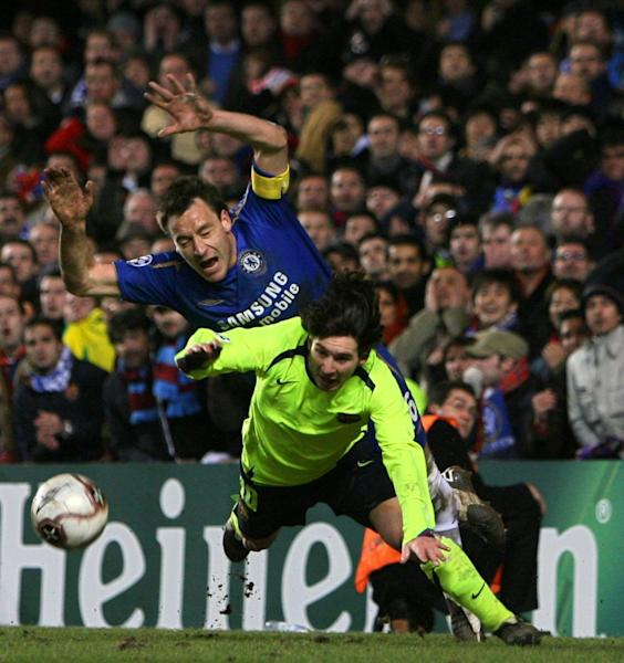 Chelsea's John Terry (L) dives over the ball with Barcelona's Lionel Messi during a Champions League game at Stamford Bridge in London in February 2006
