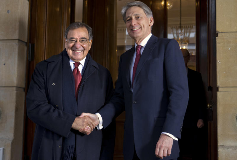 Defense Secretary Leon Panetta, left, and British Defense Minister Philip Hammond, shake hands for photographers before their meeting at Lancaster House in London, Saturday, Jan. 19, 2013, on the last day of Panetta's final overseas trip. (AP Photo/Jacquelyn Martin)