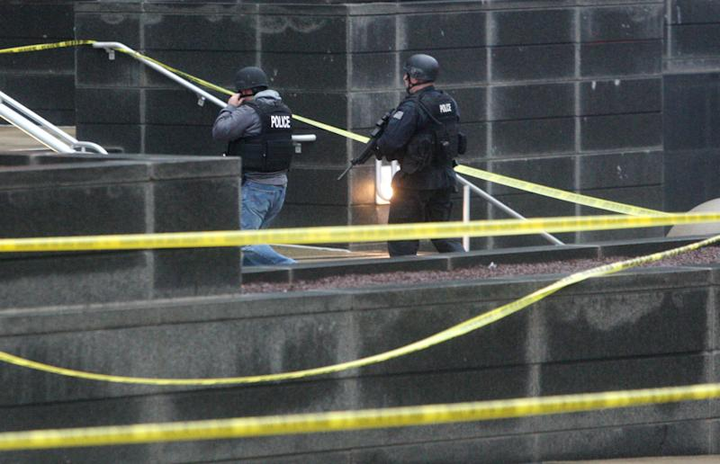 Heavily armed police enter the New Castle County Courthouse, Monday morning, Feb. 11, 2013 in Wilmington, Del. The mayor of Wilmington, Del., says a man suspected of killing his wife and wounding two others at the New Castle County Courthouse has been killed by police. (AP Photo/The News Journal/William Bretzger) PHILADELPHIA TV OUT AND PHILADELPHIA ONLINE SITES OUT
