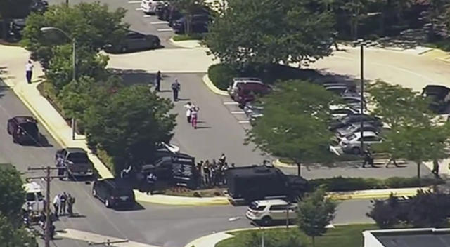 <p>In this frame from video, people leave the Capital Gazette newspaper after multiple people have been shot on Thursday, June 28, 2018, in Annapolis, Md. (Photo: WJLA via AP) </p>