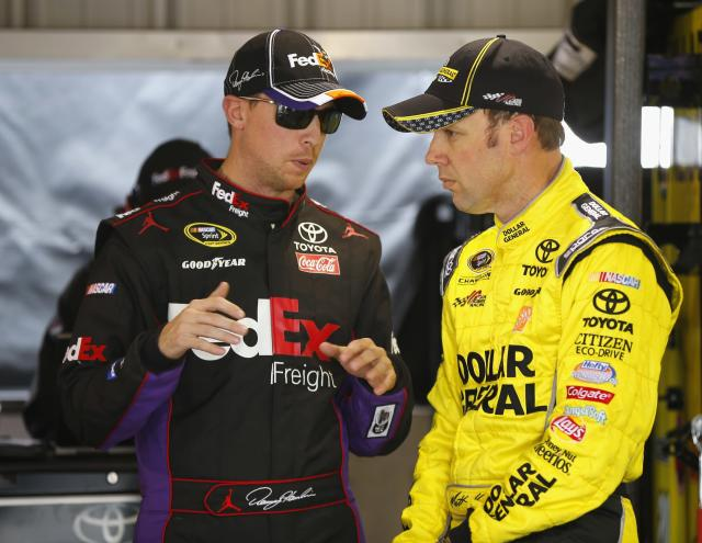 MARTINSVILLE, VA - MARCH 28: (L-R) Denny Hamlin, driver of the #11 FedEx Freight Toyota, talks with Matt Kenseth, driver of the #20 Dollar General Toyota, in the garage area during practice for the NASCAR Sprint Cup Series STP 500 at Martinsville Speedway on March 28, 2014 in Martinsville, Virginia. (Photo by Matt Sullivan/Getty Images)