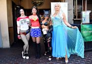 <p>Cosplayers dressed as Harley Quinn, Wonder Woman, Catwoman, and <em>Frozen</em>'s Elsa at Comic-Con International on July 19, 2018, in San Diego. (Photo: Araya Diaz/Getty Images) </p>