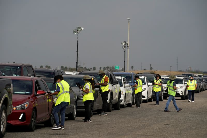 FILE PHOTO: People are inoculated against coronavirus disease at a vaccination site in Robstown