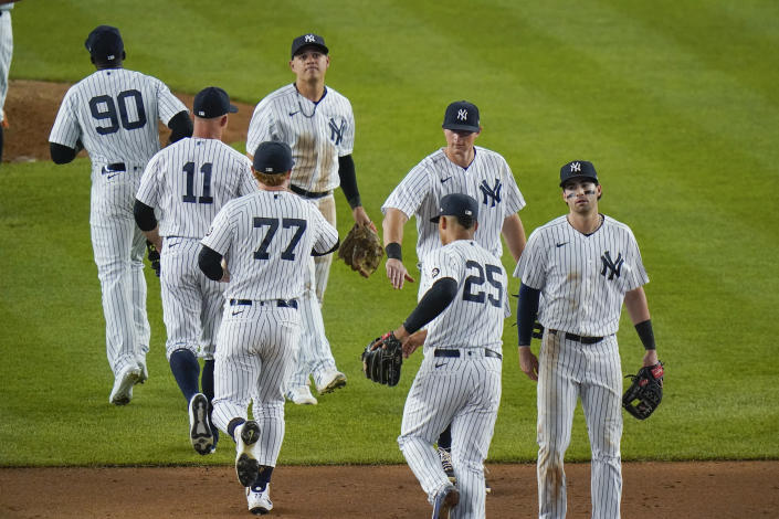 The New York Yankees celebrate their win against the Toronto Blue Jays after the second game of a baseball doubleheader Thursday, May 27, 2021, in New York. The Yankees won 5-3. (AP Photo/Frank Franklin II)