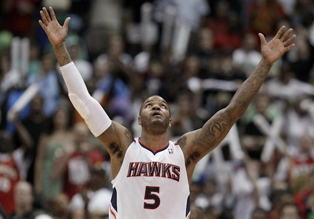Atlanta Hawks' Josh Smith celebrates after the Hawks beat the Boston Celtics 83-74 in Game 1 of an opening-round NBA basketball playoff series Sunday, April 29, 2012, in Atlanta. (AP Photo/David Goldman)