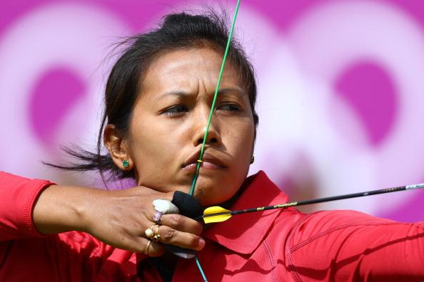 LONDON, ENGLAND - JULY 30:  Laishram Bombayala Devi of India competes in her Women's Individual 1/16 Eliminations Archery match against Aida Roman of Mexico on Day 3 at Lord's Cricket Ground on July 30, 2012 in London, England.  (Photo by Paul Gilham/Getty Images)