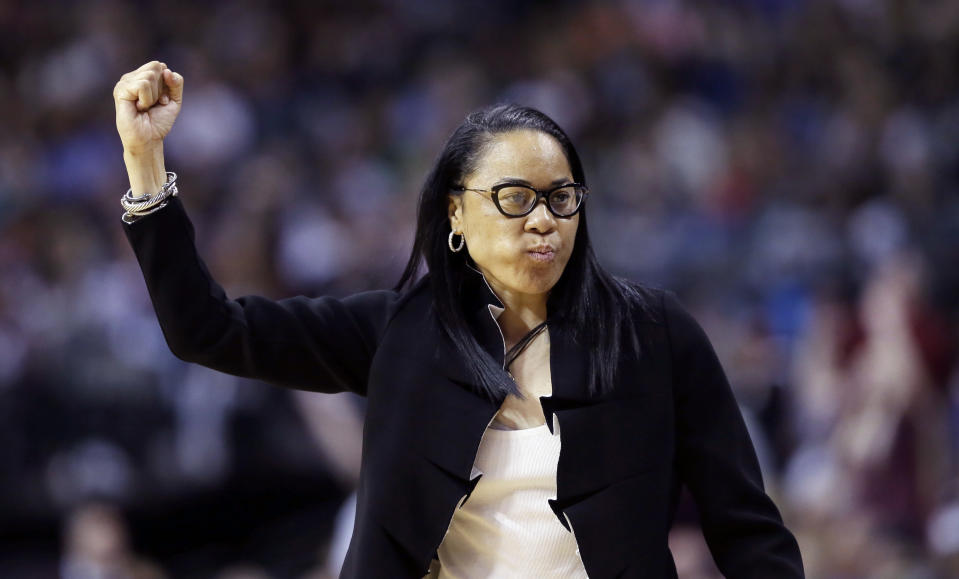 Dawn Staley says she'll visit Donald Trump if invited. (AP)