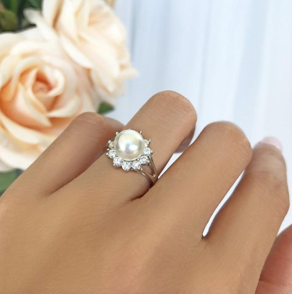 <p>For a statement piece that will garner tons of compliments, go for this <span>Pearl Halo Engagement Ring</span> ($78 and up).</p>