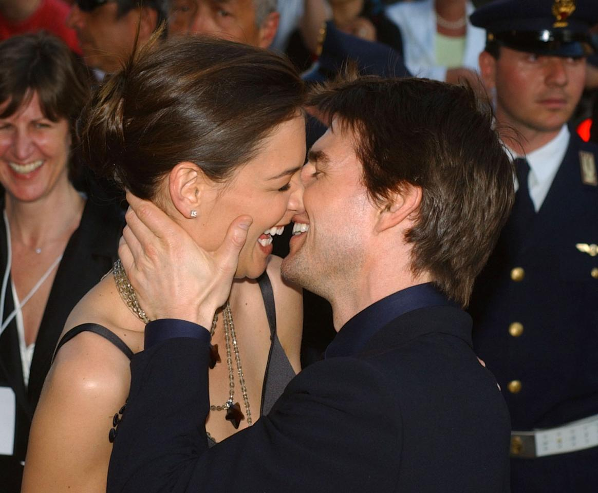 FILE - In this Friday April 29, 2005 file photo,Tom Cruise, right, and Katie Holmes laugh as they on Via della Conciliazione Boulevard near St. Peter's Basilica, as they arrive at the St. Cecilia auditorium for the David di Donatello Italian film awards, in Rome. Holmes' attorney Jonathan Wolfe said Friday June 29, 2012 that the couple is divorcing, but called it a private matter for the family. (AP Photo/Corrado Giambalvo, File)