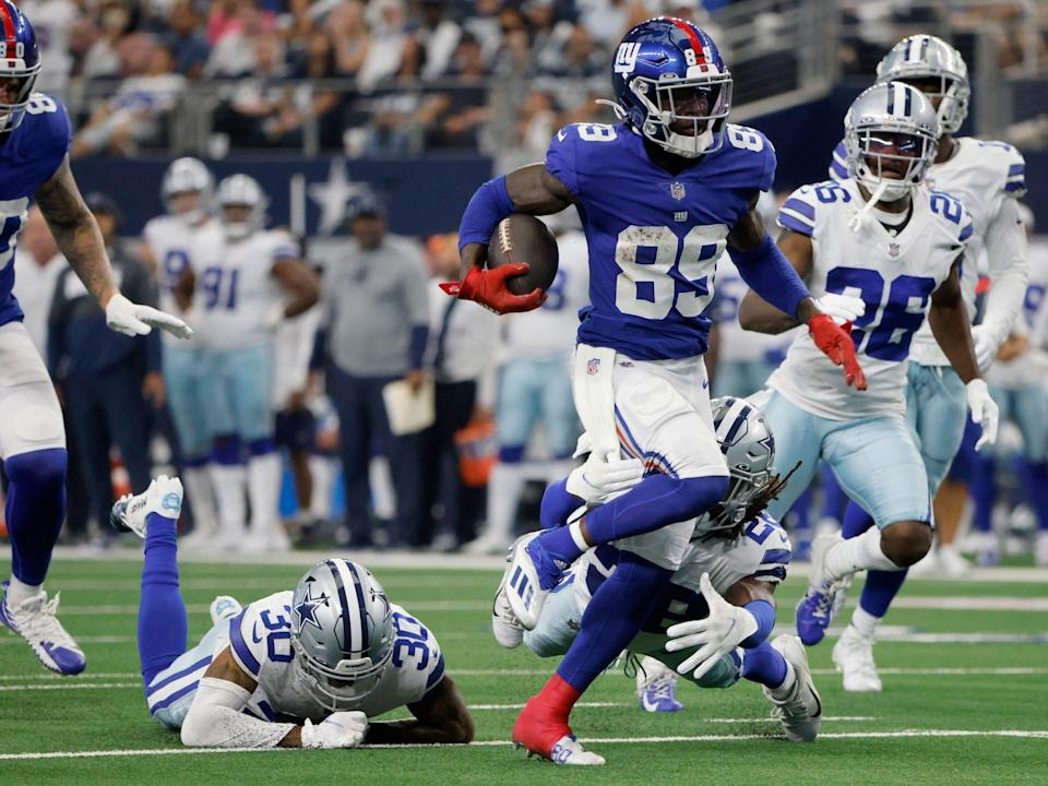 Kadarius Toney breaks free from a tackle against the Dallas Cowboys.