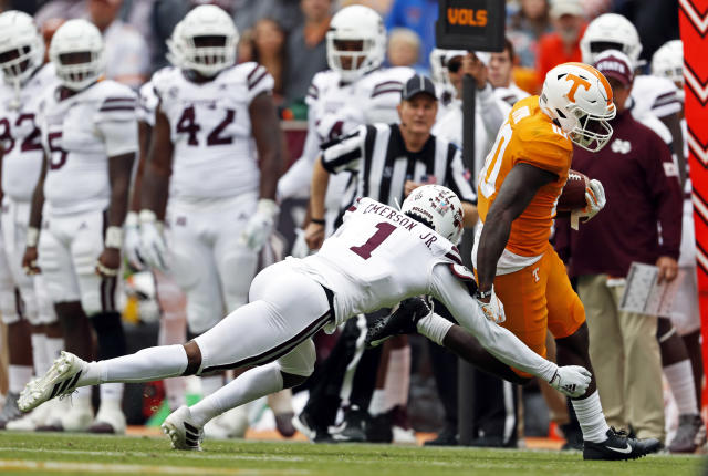 Tennessee wide receiver Tyler Byrd (10) runs for a touchdown as he's hit by Mississippi State cornerback Martin Emerson (1) in the second half of an NCAA college football game Saturday, Oct. 12, 2019, in Knoxville, Tenn. (AP Photo/Wade Payne)