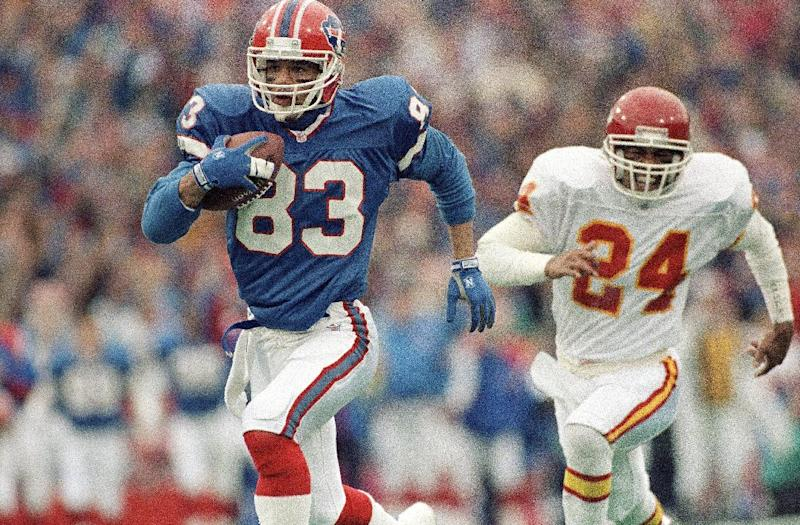 FILE - In this Jan. 15, 1992 file photo, Buffalo Bills wide receiver Andre Reed runs with the ball during an AFC playoff football game against the Kansas City Chiefs in Orchard Park, N.Y. Reed was elected to the Pro Football Hall of Fame on Saturday, Feb. 1, 2014. (AP Photo/Mark Duncan, File)