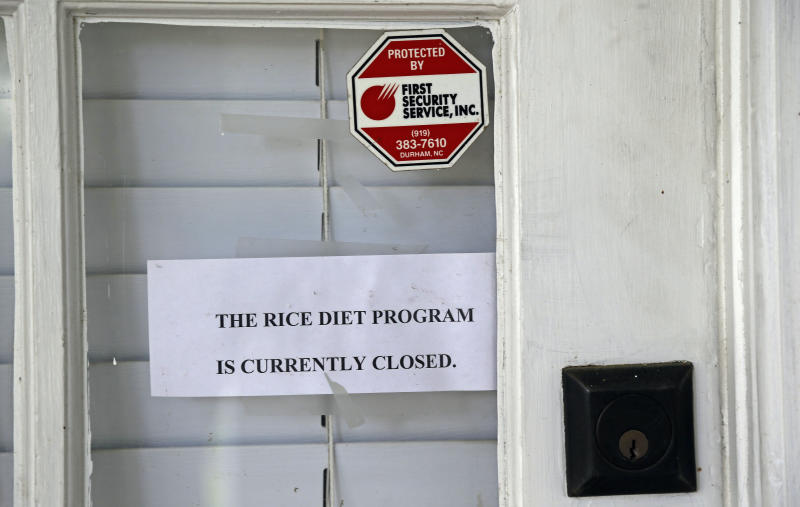 This Tuesday, Aug. 27, 2013 photo shows a sign at the entrance to the now-closed Rice Diet facility in Durham, N.C. The company that took the Rice Diet banner after Duke University's hospital spun it off a decade ago has closed after more than 70 years of attracting celebrities and others suffering chronic illness and obesity to Durham. (AP Photo/Gerry Broome)