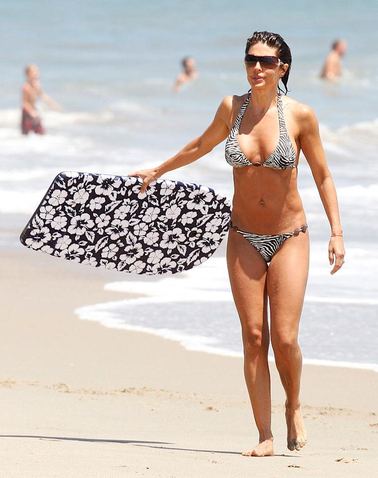 """Former soap siren Lisa Rinna is flawless for 44. Toned and tanned to perfection! MAP/<a href=""""http://www.splashnewsonline.com"""" target=""""new"""">Splash News</a> - June 29, 2008"""