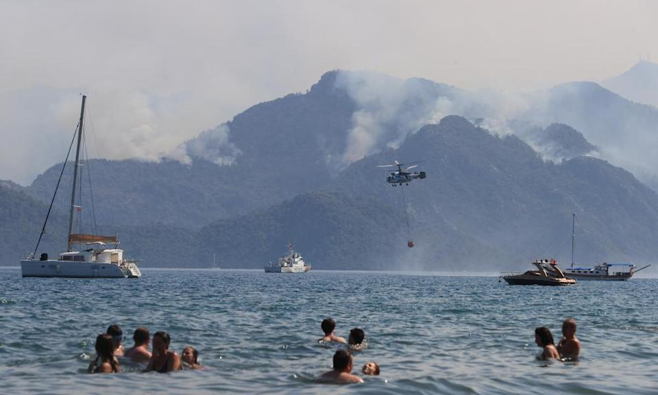 A helicopter responds to the forest fire that broke out in Marmaris district in Mugla, Turkey.