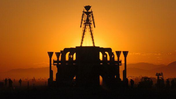 PHOTO: In this Sept. 2, 2006 file photo, The Man, a stick figured symbol of the Burning Man art festival, is silhouetted against a morning sunrise in Nevada's Black Rock Desert. (Ron Lewis/AP)