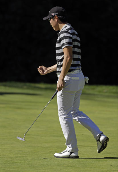 Sang-Moon Bae, of South Korea, reacts after making birdie on the sixth hole in the second round of the Northern Trust Open golf tournament at Riviera Country Club in the Pacific Palisades area of Los Angeles Friday, Feb. 15, 2013. (AP Photo/Reed Saxon)