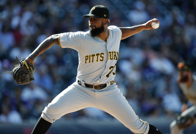 FILE - In this Sept. 1, 2019, file photo, Pittsburgh Pirates pitcher Felipe Vazquez works against the Colorado Rockies in the ninth inning of a baseball game in Denver. Pirates All-Star closer Felipe Vazquez has been arrested on charges of pornography and soliciting a child. Vazquez was taken into custody Tuesday morning, Sept. 17, 2019, by Pennsylvania State Police on one count of computer pornography/solicitation of a child and one count of providing obscene material to minors. (AP Photo/David Zalubowski, File)