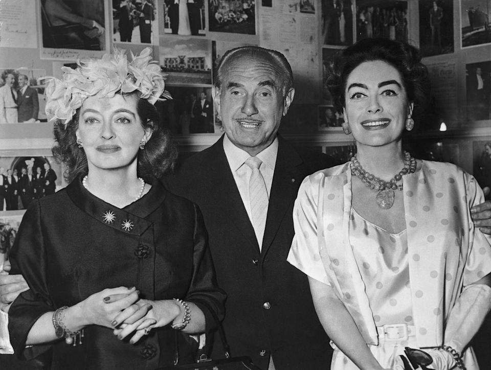 <p>Davis with iconic producer Jack L Warner and Joan Crawford, with whom she co-starred in 1962's <em>Whatever Happened to Baby Jane? </em></p>