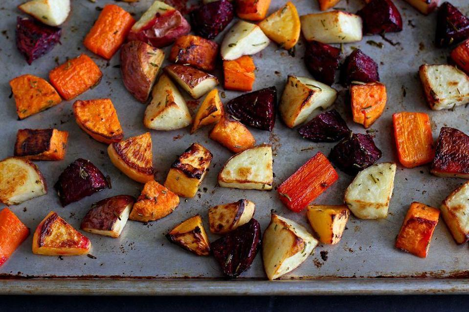 """<p>For a side dish that looks almost as good as it tastes, try this colorful mix of sweet and red-skinned potatoes, carrots, beets, and rutabagas. You can also swap in parsnips, red onions, or turnips.</p><p><strong>Get the recipe from <a href=""""https://www.thepioneerwoman.com/food-cooking/recipes/a82638/roasted-rosemary-root-vegetables/"""" rel=""""nofollow noopener"""" target=""""_blank"""" data-ylk=""""slk:Dara Michalski"""" class=""""link rapid-noclick-resp"""">Dara Michalski</a>.</strong></p><p><a class=""""link rapid-noclick-resp"""" href=""""https://go.redirectingat.com?id=74968X1596630&url=https%3A%2F%2Fwww.walmart.com%2Fbrowse%2Fhome%2Fbaking-cookie-sheets%2F4044_623679_8455465_6795877&sref=https%3A%2F%2Fwww.thepioneerwoman.com%2Ffood-cooking%2Fmeals-menus%2Fg36876289%2Fsweet-potato-side-dishes%2F"""" rel=""""nofollow noopener"""" target=""""_blank"""" data-ylk=""""slk:SHOP SHEET PANS"""">SHOP SHEET PANS</a></p>"""