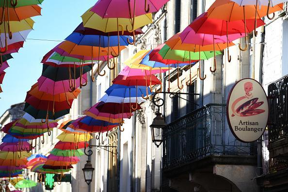 Colourful umbrellas hang above the main street as part of a summer art installation to brighten the town for locals and visitors on June 25, 2018 in Sainte-Foy-La-Grande, France. The town lies 80km west from Bordeaux in South West France and is on the famous River Dordogne where thousands of visitors enjoy the summer months each year. (Photo by James D. Morgan/Getty Images)