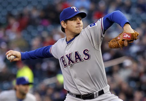 Texas Rangers starting pitcher Nick Tepesch throws against the Minnesota Twins during the first inning of a baseball game on Thursday, April 25, 2013, in Minneapolis. (AP Photo/Genevieve Ross)