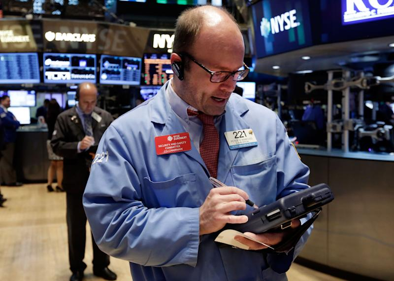 Trader Peter Mancuso works on the floor of the New York Stock Exchange, Tuesday, May 13, 2014. The Standard & Poor's 500 index crossed above 1,900 for the first time Tuesday as investors assessed news on retail sales. DirecTV gained on reports that the AT&T is poised to buy the company for nearly $50 billion. (AP Photo)