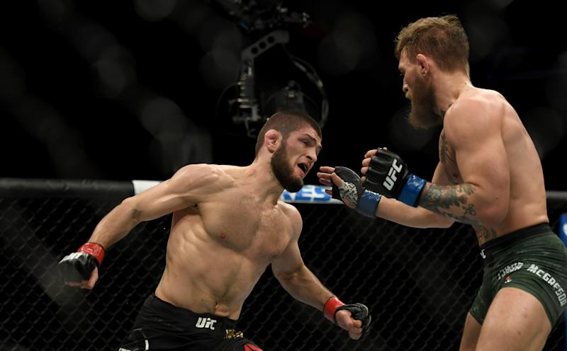 LAS VEGAS, CA - OCTOBER 06: Khabib Nurmagomedov lands a punch dropping Conor McGregor during their fight at UFC 229 at the T-Mobile Arena in Las Vegas, Nev. Friday, Oct. 6, 2018. (Photo by Hans Gutknecht/Digital First Media/Los Angeles Daily News via Getty Images)