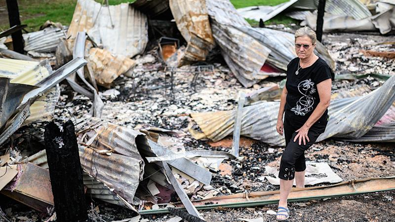 Averill Berryman looking at the remains of her Real Estate and Dog Grooming businesses which were both destroyed by the New Years Eve bush fire in Mogo. Source: AAP