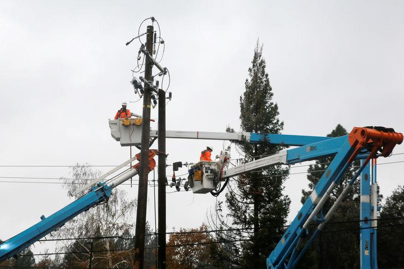 PG&E crew work on power lines to repair damage caused by the Camp Fire in Paradise,