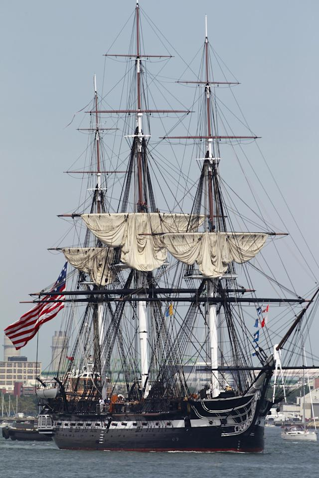 The USS Constitution is escorted by a tugboat in Boston Harbor in Boston, Sunday, Aug. 19, 2012. The USS Constitution, the U.S. Navy's oldest commissioned war ship, sailed under her own power during the event Sunday for the first time since 1997. The sail was held to commemorate the 200th anniversary of the ship's victory over HMS Guerriere in the War of 1812. (AP Photo/Steven Senne)